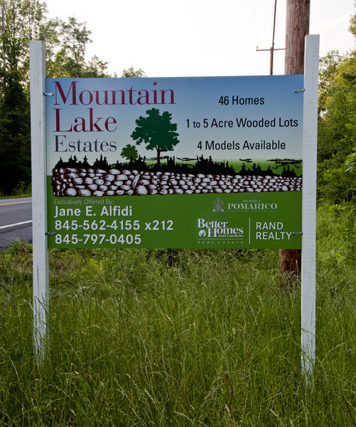 mountain lake estates real estate new development sign