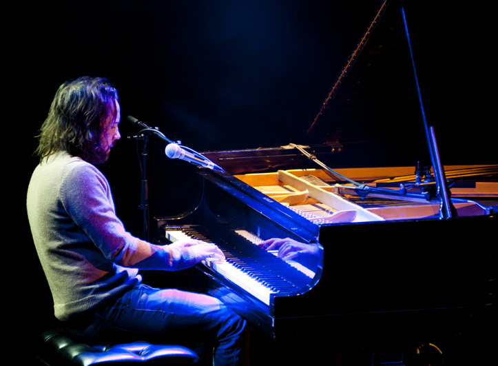 Photo of Kevin Drew Playing Piano