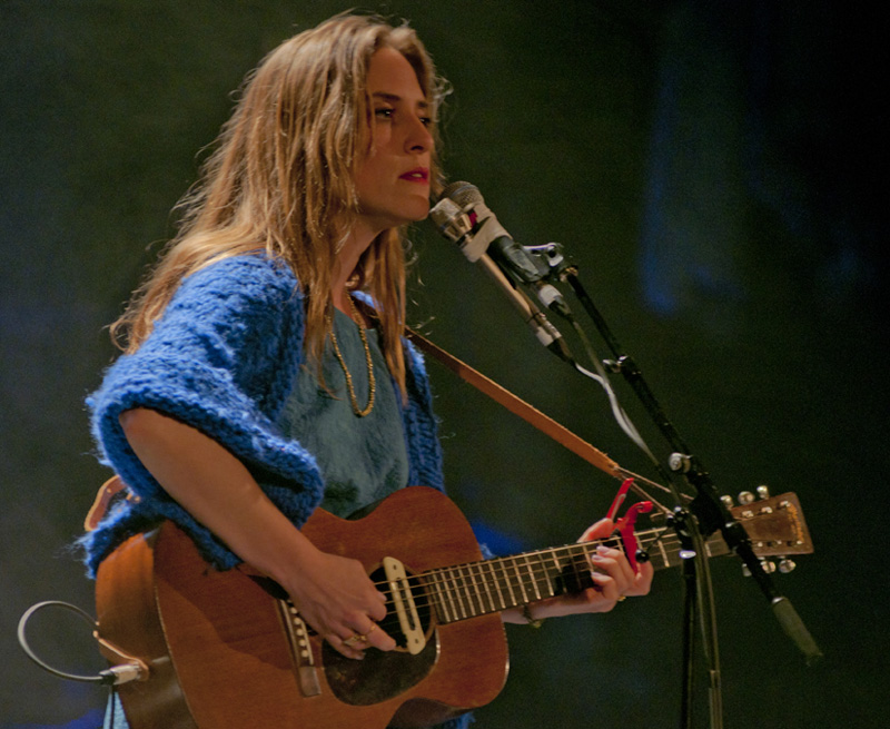 Photo of Feist Playing Guitar