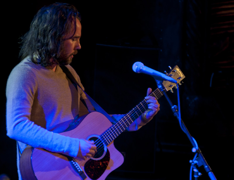 Photo of Kevin Drew playing guitar