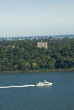 A Yacht cruises past The Bronx on the Hudson River in New York City