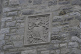 An owl stone relief carving on a building in Montreal