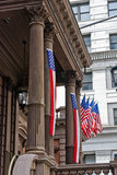 Flags and columns on the Union League building in Philadelphia. The building was from the United States Civil War era and used to raise money for the war effort and as a recruiting station.