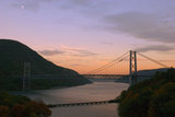 The Bear Mountain Bridge Crosses the Hudson River with Anthony's Nose Mountain in the background at Sunset