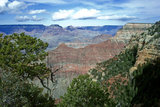 The rock formation known as the Battleship juts out towards the Colorado River in the Grand Canyon.