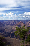 Clouds begin to break apart over The Grand Canyon following a Spring rain storm with torrential down pours