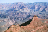 O'Neill Butte springs up along the Grand Canyon.
