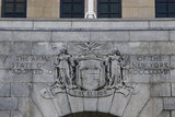 The Seal of the state of New York as a stone relief in the New York State Capitol building